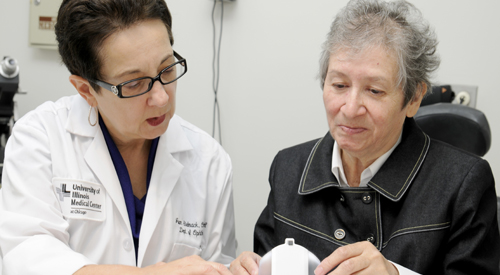 Dr. Joan Stelmack assists a low vision patient